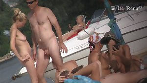 Beach nudist couple having sex in water on voyeur cam
